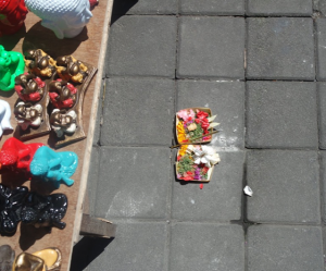 Colourful incense, gifts and foods, are left on the floor by hindu worshippers.